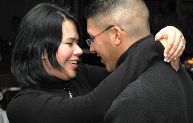 PETERSON AIR FORCE BASE, Colo. -- Airman 1st Class Mike Robles and his wife, Liza, enjoy a private moment during a slow dance at the 50th Space Wing Holiday Party Friday at the Peterson Air Force Base Consolidated Club. Airman Robles helped set up audiovisual equipment before the party. (U.S. Air Force photo/Staff Sgt. Don Branum)