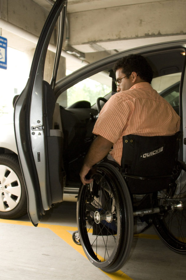 16400-a-disabled-man-in-a-wheelchair-getting-out-of-a-car-pv